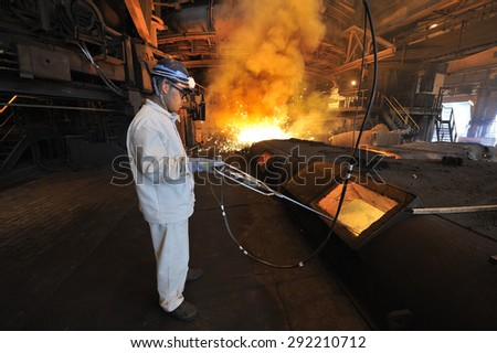 Belo Horizonte, Minas Gerais, Brazil : June. 27.2008 : Usiminas, Brazil�¢??s biggest steel mill, worker at the blast furnace, Belo Horizonte, Minas Gerais, Brazil - stock photo