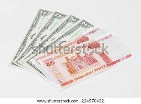 Belorussian currency and 2-dollars bank note - stock photo
