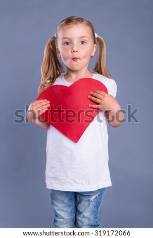 beloved little cute girl holding heart - stock photo
