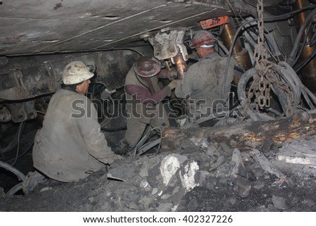 BELOVO, RUSSIA JULY 17, 2015: Miners perform installation of structures below ground in the mine