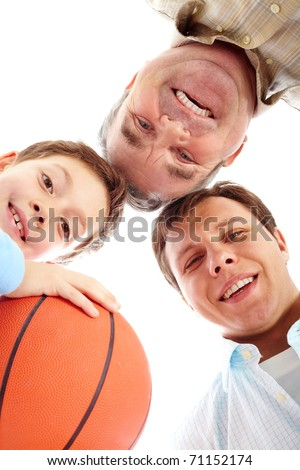 Below view of father, boy with ball and a grandfather - stock photo