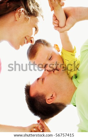 Below view of happy family members having good time on sunny day - stock photo