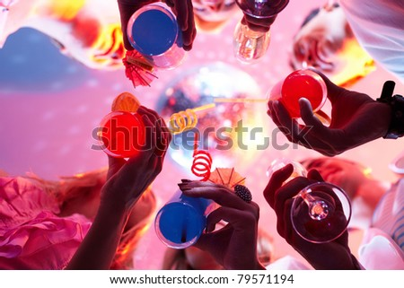 Below view of people clinking glasses with each other - stock photo