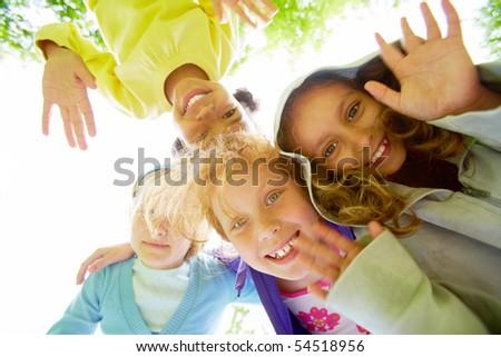 Below view of several happy girls looking at camera - stock photo