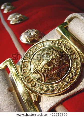 Belt buckle of Guard at Buckingham Palace in London, England - stock photo