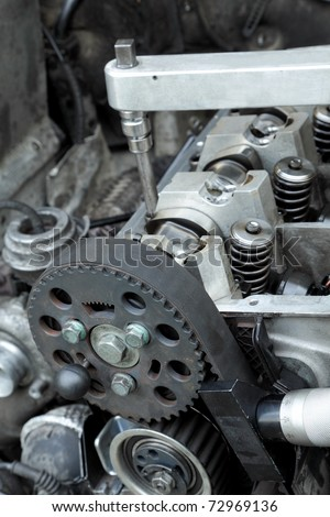 Belt, gear,  springs and camshaft of  car engine with socket wrench - stock photo
