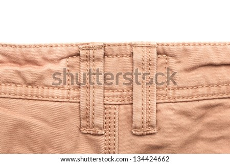 Belt line on a pair of casual trousers - stock photo