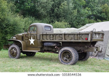 BELTRING, UK - JULY 27: A WW2 US flatbed supply truck stands on static display in one of the back fields at the War & Peace Revival show on July 27, 2017 in Beltring