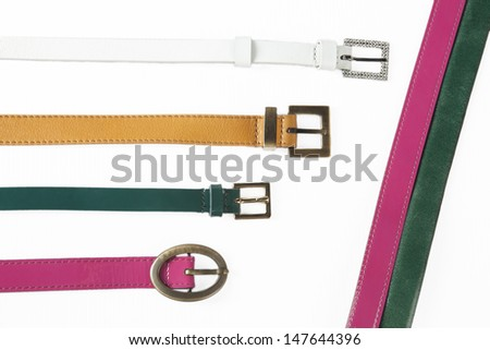 Belts. Set of different leather belts isolated on white background - stock photo