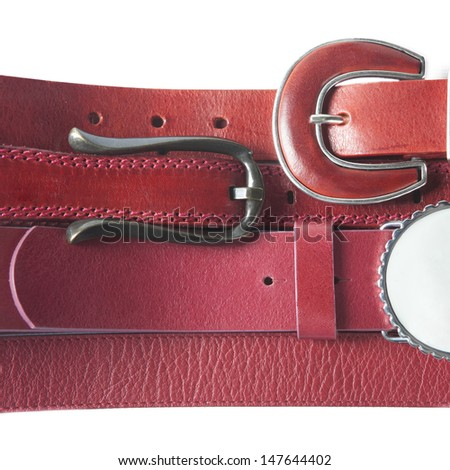 Belts. Set of red leather belts isolated on white background - stock photo