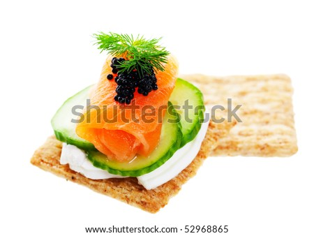 Beluga Caviar on fresh, raw salmon with baby cucumber and goat cheese; garnished with a sprig of fresh dill. - stock photo