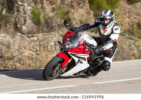 """BEMBIBRE, SPAIN - JUNE 23: Motorcyclist unidentified with Honda CBR 600F in the 3rd motorcycle rally """"Bierzorros"""" in Bembibre (Leon) on June 23, 2012 in Bembibre, Spain. - stock photo"""