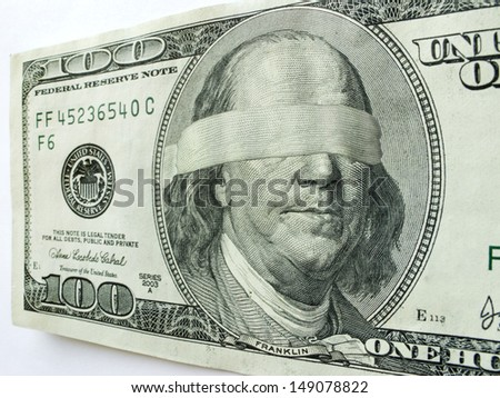 Ben Franklin Blindfolded on One Hundred Dollar Bill illustrates mixed Economic direction or uncertainty, business troubles, profits, income tax issues, budget shortfalls, salaries and revenue/income - stock photo