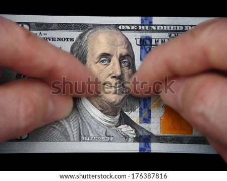 Ben Franklin Smiling Frankly Over His New Threads, The New One Hundred Dollar Federal Reserve Note. I have added more lifelike coloration to Ben's face and hair and gave him a bit happier expression.  - stock photo