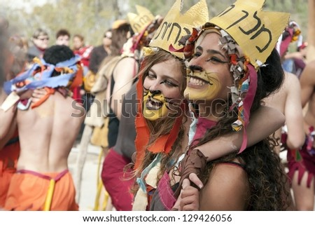 BEN-GURION--FEB 22: Unidentified children go through the streets  during a procession on the feast of Purim on  February 22, 2013 in Midreshet Ben-Gurion,Israel - stock photo