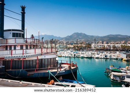 BENALMADENA CITY, SPAIN - APRIL 12, 2011: Vintage Mississipi Willow paddle steamer, built in 1925, now a restaurant and the panorama of Benalmadena Town - stock photo