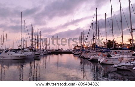 BENALMADENA, MALAGA, SPAIN: photo of a cloudy sunset in Puerto Marina in Benalmadena, at Costa del Sol, Malaga.  Opened on 1987, is one of the biggest leisure ports in Andalusia.