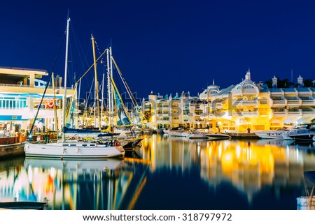 Benalmadena, Spain - June 19, 2015: Night Scenery View of floating houses, vessel in Puerto Marina. Malaga region, on the Costa del Sol. It caters for a large number of tourists. - stock photo