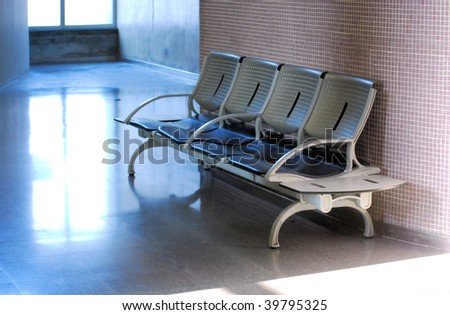 bench and armchairs in a waiting room of  terminal of seaport in barcelona, spain, catalonia