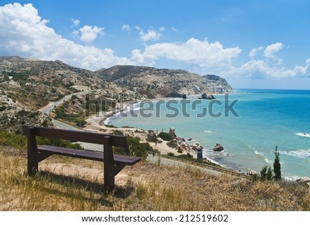 bench at observation point over Petra tou Romiou in Cyprus  - stock photo