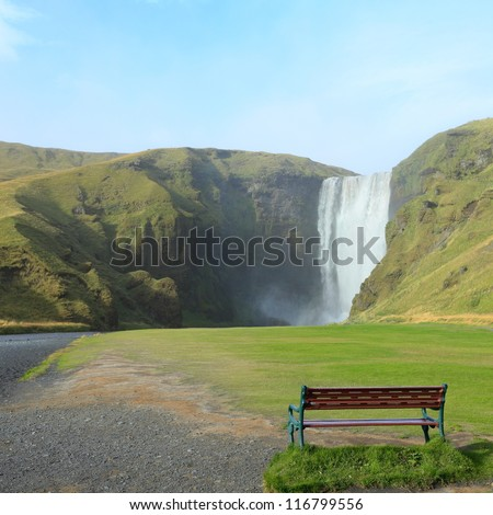 bench at Skogafoss, Iceland - stock photo