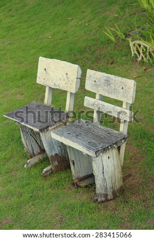 Bench chair in a garden at the park - stock photo