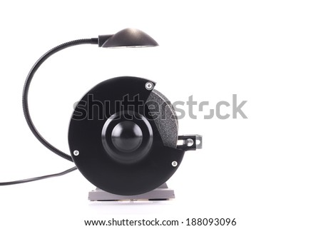 Bench grinder with lamp isolated on white, side view