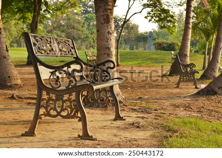 Bench in a park in spring time - stock photo