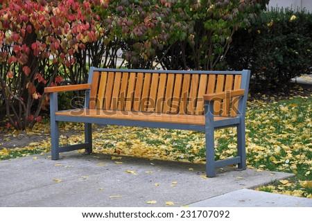 Bench in autumn - stock photo