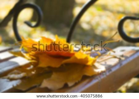 Bench in autumn park. Autumn landscape. - stock photo