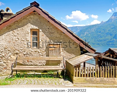 Bench in front of an old building - stock photo