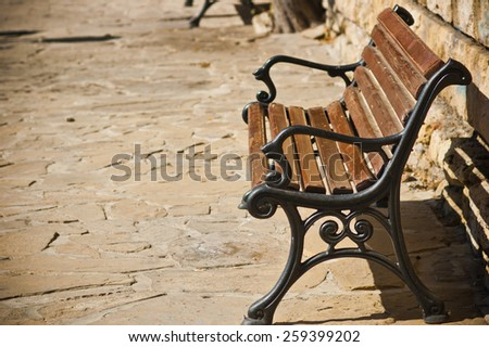 Bench in old town - stock photo
