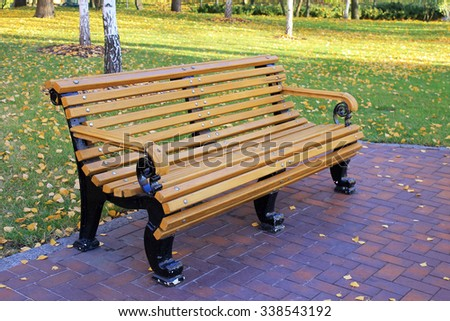 bench in the autumn park, selective focus - stock photo