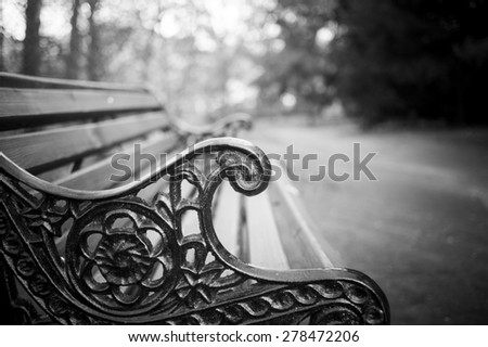 Bench in the park closeup in monochrome tones - stock photo