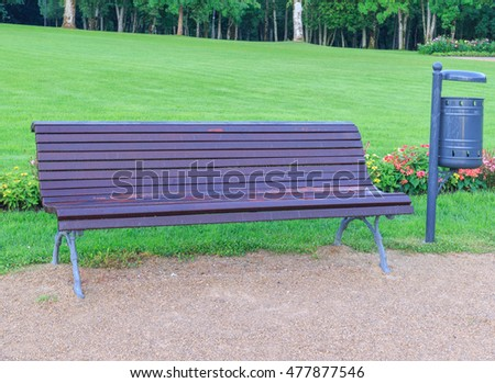 Bench in the park covered with dew drops