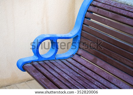 Bench in the park, Stylish bench in summer park - stock photo