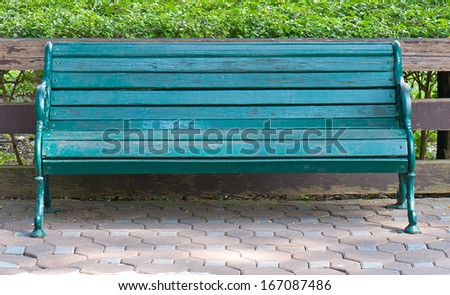 Bench in the public gardens - stock photo