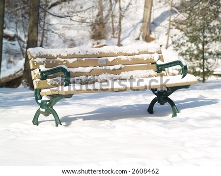 bench on a sunny winter - stock photo