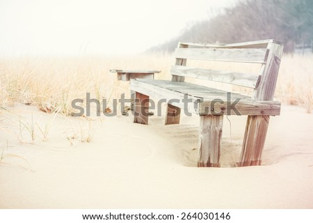 Bench on the beach at the sea. Instagram effect. - stock photo