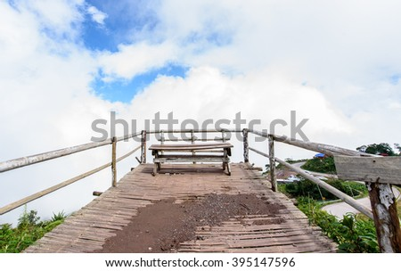 Bench On Wooden Balcony And Clear Sky - stock photo