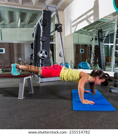 bench push up woman at gym workout exercise - stock photo