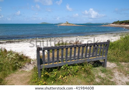 Bench with a view of Porthloo beach, St. Mary's Isles of Scilly. - stock photo