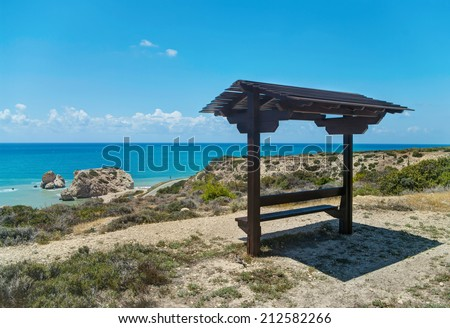 bench with roof facing petra tou romiou in Cyprus - stock photo