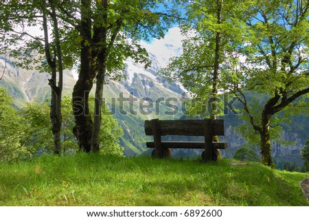 Bench with view of Swiss Alps