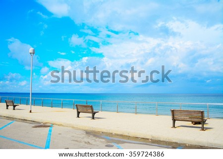 benches by the sea in Sardinia, Italy - stock photo