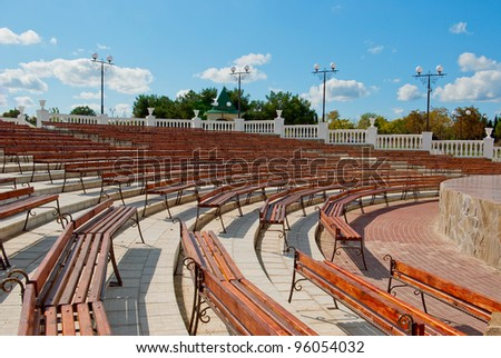 Benches facing a semicircle in front of the stage