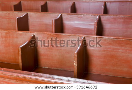 Benches in the church of Feerwerd. - stock photo