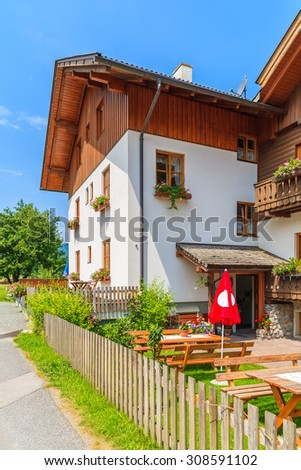 Benches with tables in typical alpine guest house in summer season, Weissensee lake, Austria - stock photo