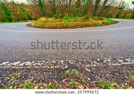Bend on the Asphalt Forest Road in Italy - stock photo