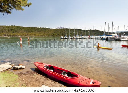 Bend,Oregon, August 21, 2011: Tourists gathered at the Elk lake in the  Bend area of Oregon for enjoying the summer. This is a popular spot for picnic and recreational activities.  - stock photo